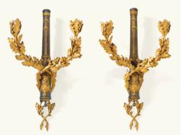 129 - IMPORTANTE PAIRE D'APPLIQUES AU CANON ET AUX ARMES DE FRANCE EN BRONZE DORÉ ET PATINÉ D'ÉPOQUE LOUIS XVI Estimate 200,000 — 400,000 EUR