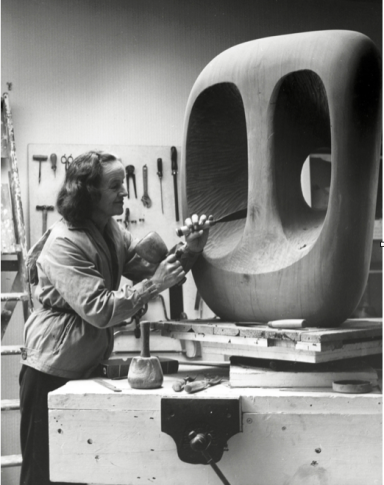 """Barbara Hepworth in the Palais studio at work on the wood carving Hollow Form with White Interior"" 1963 - 