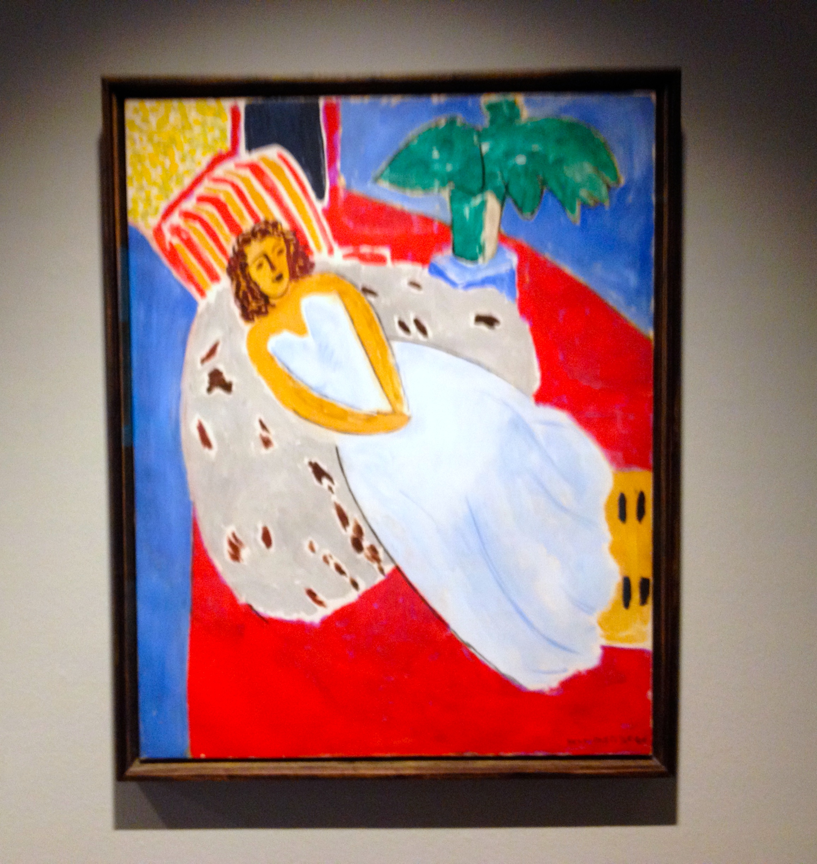 Henri Matisse Jeune femme en blanc, fond rouge 1946